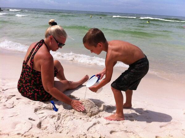 Enjoying the beach with my grandson.