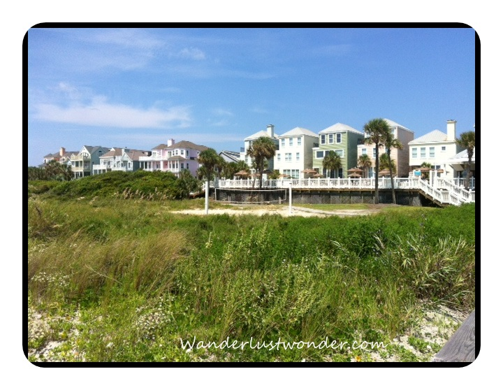 View of some condos and beach houses from the beach.