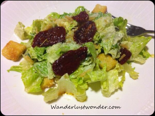 Caesar Salad with sun dried tomatoes.