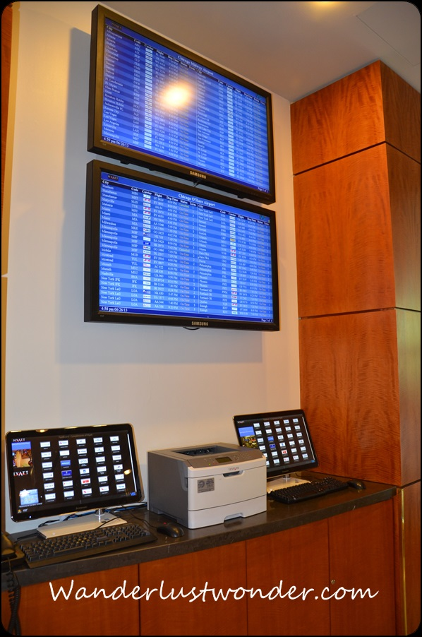 Computer monitor with local flight times.