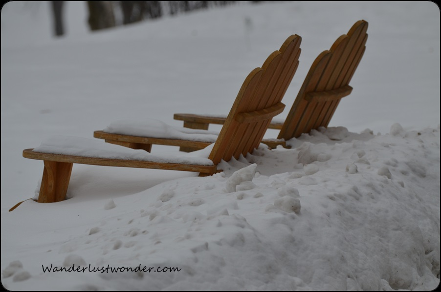 Beach chairs in the deep snow.