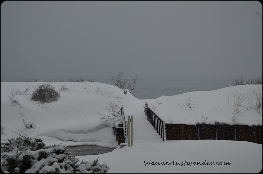 Walkway to the snow covered beach.