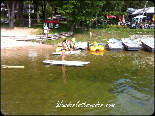 Stand up paddleboarding. Look how clear the water is!