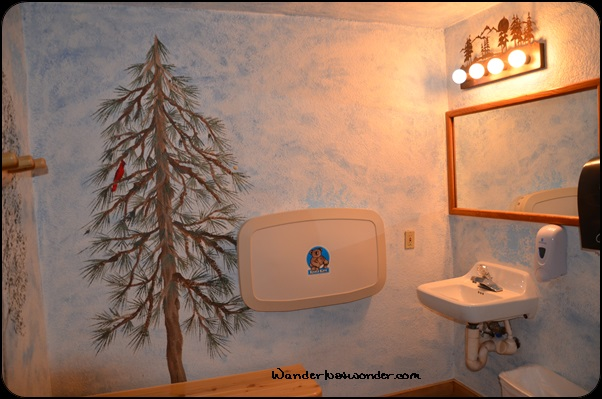Pine tree mural in one bathroom.