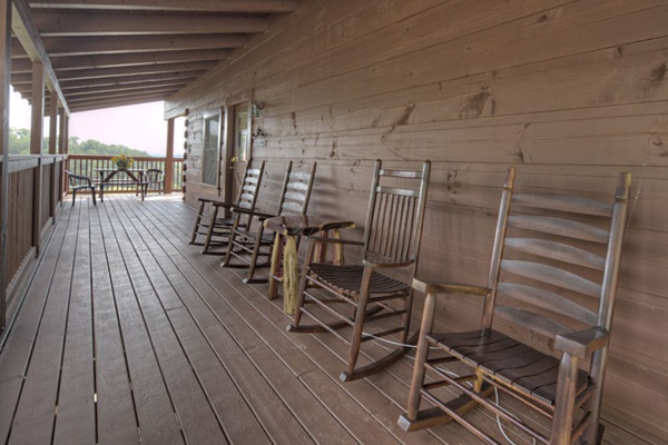 Upper level deck furnished with rocking chairs.