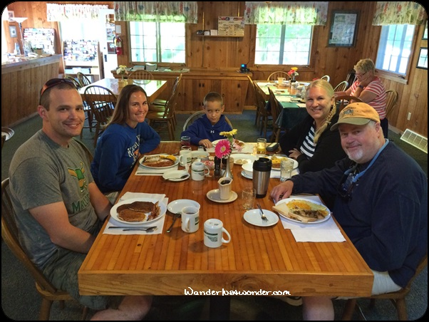 Our family at breakfast - although our grandson looks leery, he loved the pancakes!